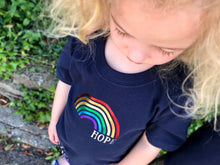 Load image into Gallery viewer, Looking down on her Rainbow of hope t-shirt