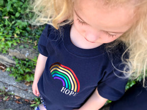 Looking down on her Rainbow of hope t-shirt