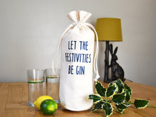 Load image into Gallery viewer, Let the festivities be gin bottle bag in glitter navy text
