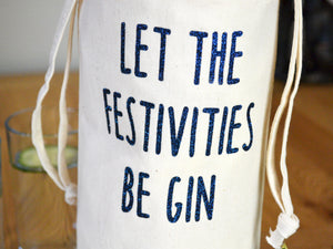 Let the festivities be gin bottle bag in glitter navy text, close up