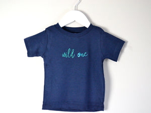Navy Wild One T-shirt on a hanger, perfect for 1st birthday baby boy