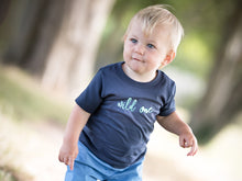 Load image into Gallery viewer, Navy Wild One T-shirt by Little Foxglove, modelled on a one year old boy
