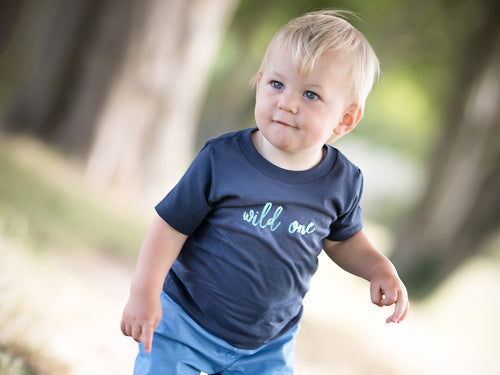 Navy Wild One T-shirt by Little Foxglove, modelled on a one year old boy