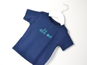 Tilted image of Wild One T-shirt on a hanger, great first birthday gift