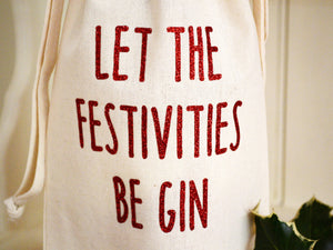 Let the festivities be gin bottle bag in glitter red text, close up