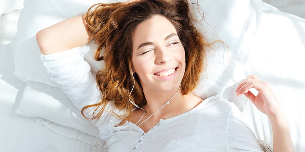 smiling woman waking up in the morning