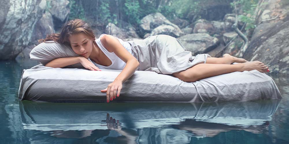 woman on a bed floating on water