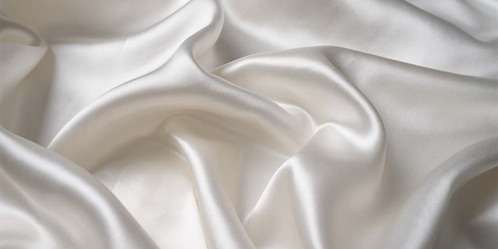 closeup of white flowing silk ft. Blissy