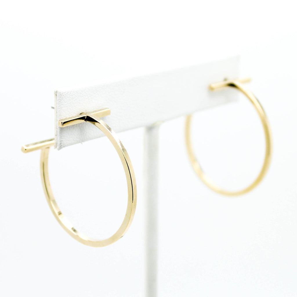 T hoop earrings