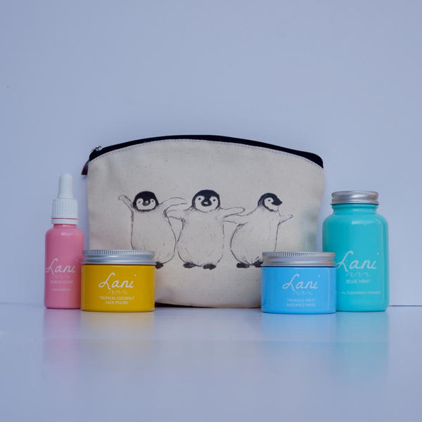 Lani Tropical Fruit Gift Set - glow serum, coco face polish, fruit face mask, mint cleanser in penguin wash bag