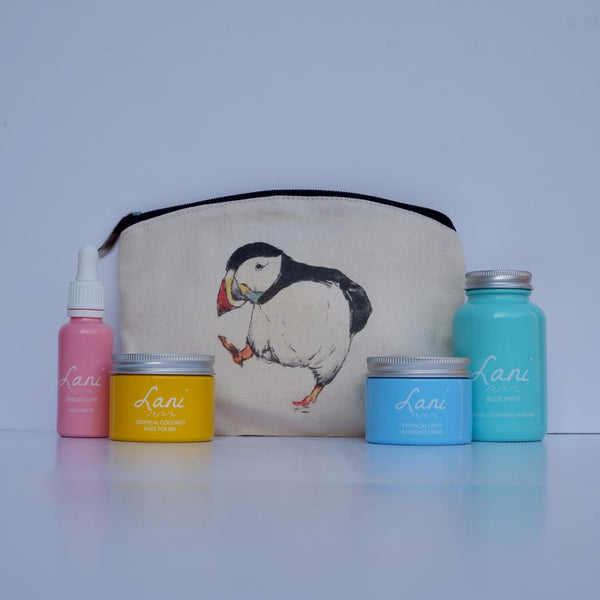 Lani Tropical Fruit Gift Set - glow serum, coco face polish, fruit face mask, mint cleanser in puffin wash bag