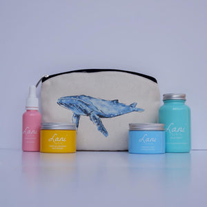 Lani Tropical Fruit Gift Set - glow serum, coco face polish, fruit face mask, mint cleanser in blue whale wash bag