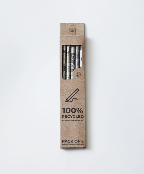Recycled newspaper waste pencils in recycled cardboard box