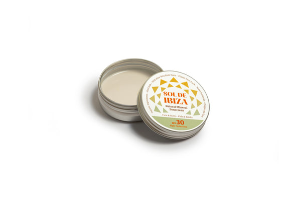 Plastic free vegan sun cream in aluminium tin, lid open showing cream