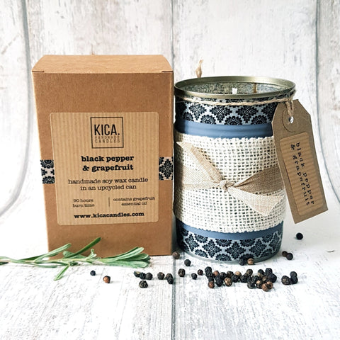 Kica Living - upcycled candle - black pepper and grapefruit. Hand decorated black pattern with rustic bow next to outer cardboard box