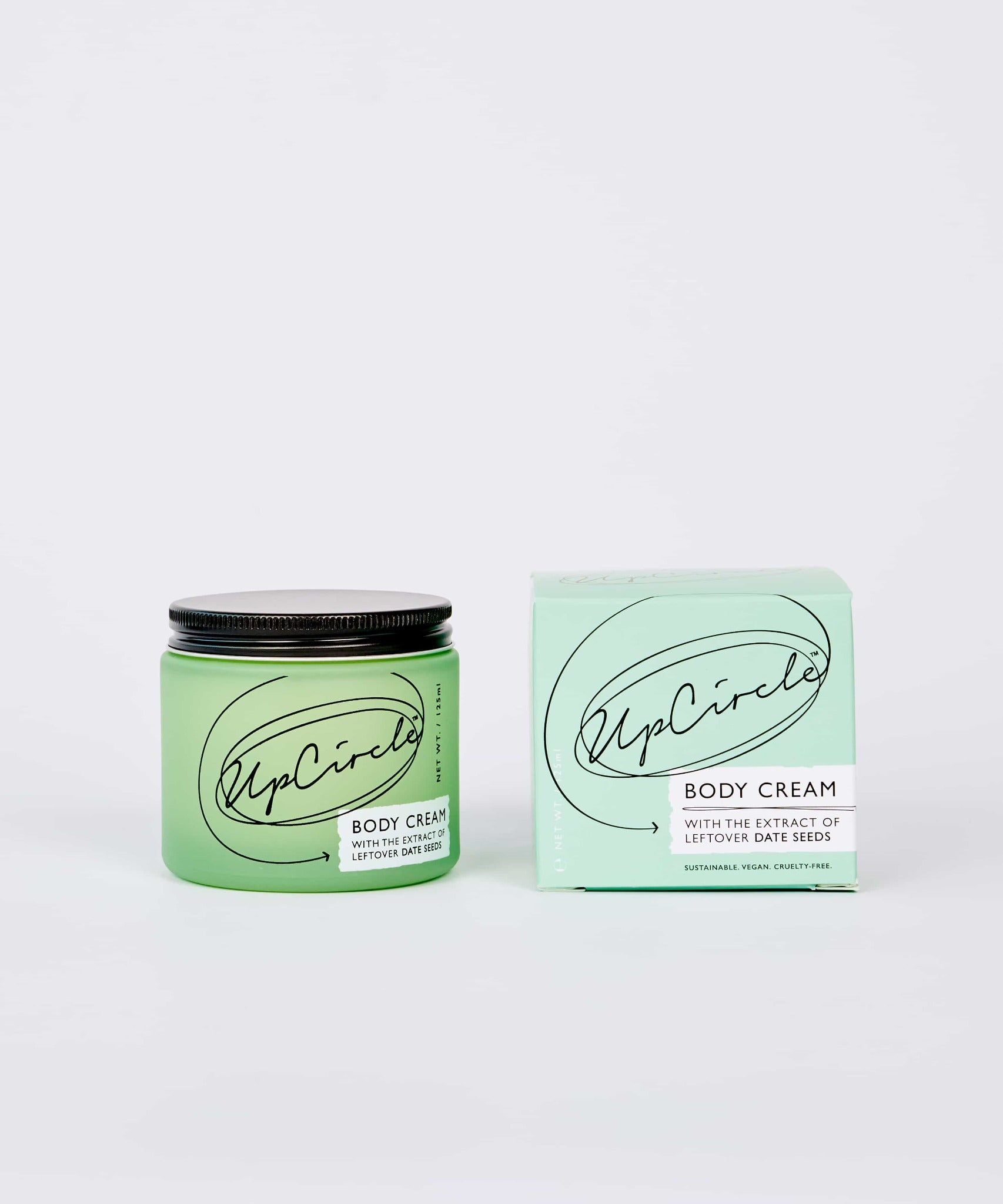 UpCircle Body Cream, glass jar next to outer cardboard box