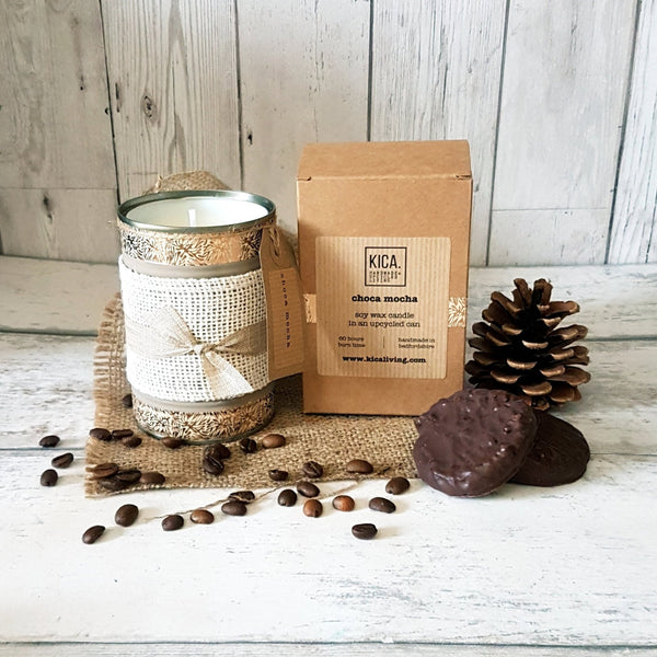 Upcycled choca mocha candle in gold tin with rustic bow next to outer cardboard box