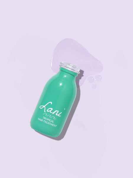 Lani Tropical Hair Treatment in turquoise glass bottle - bottle open