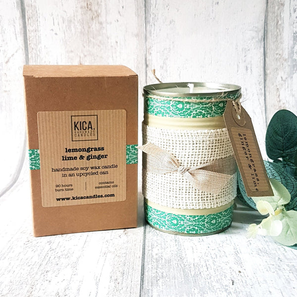 Kica Living - upcycled candle - lemongrass, ginger and lime. Green patterned tin with rustic bow next to outer cardboard box