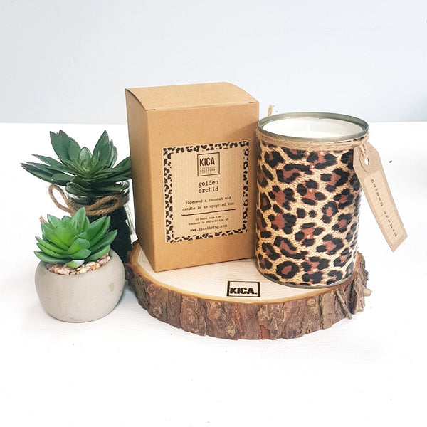 Kica Living - upcycled candle next to outer cardboard box - leopard design