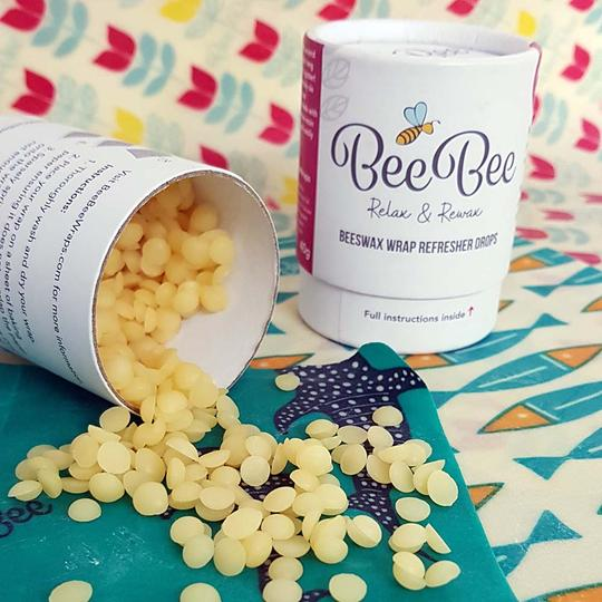 BeeBee wax refresher drops coming out the cardboard tube onto wax wraps