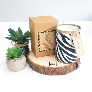 Kica Living - upcycled candle next to outer cardboard box - zebra design