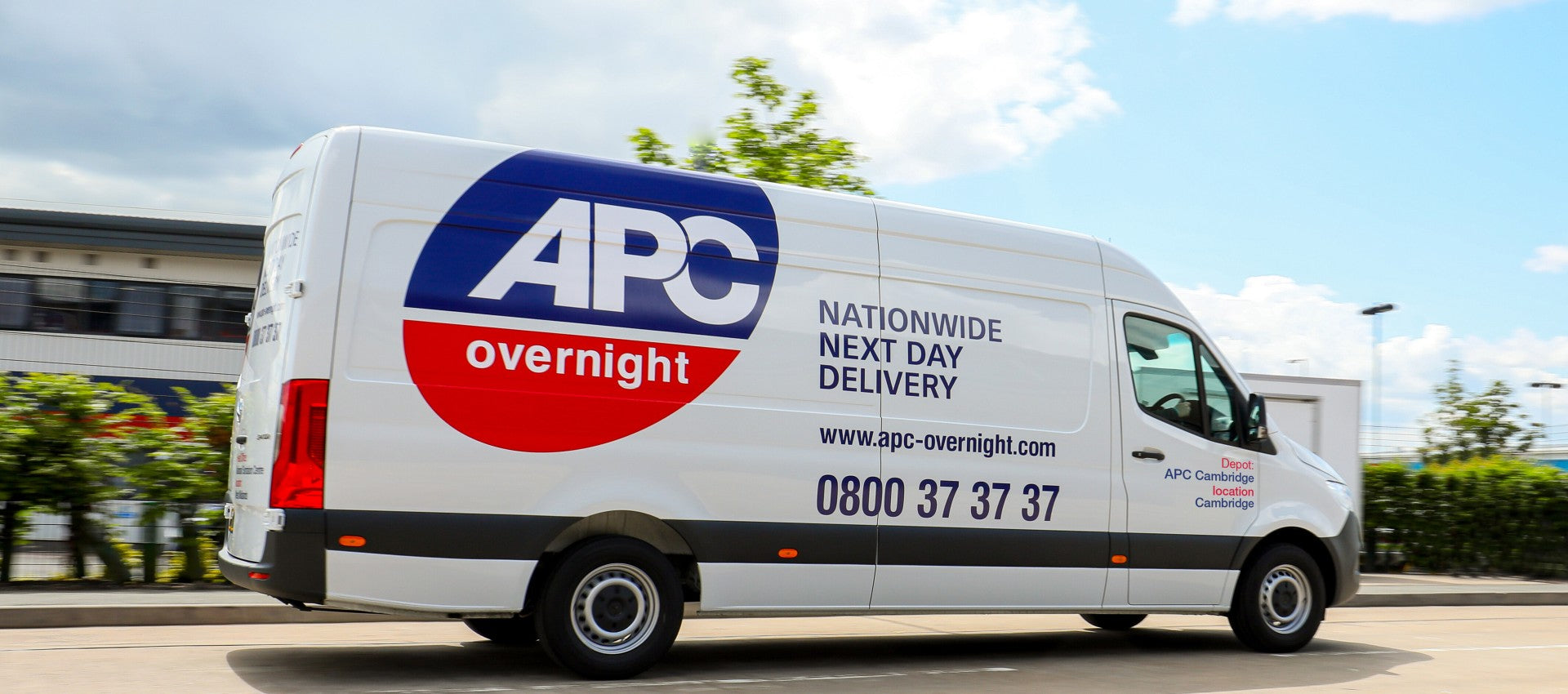 APC Overnight delivery van travelling on the road.