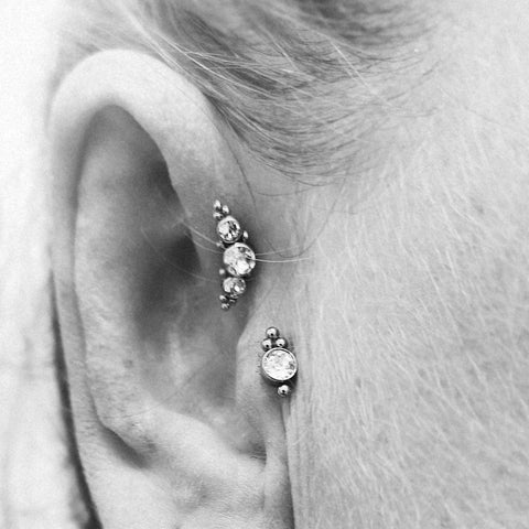 Titanium couture forward helix and tragus piercing