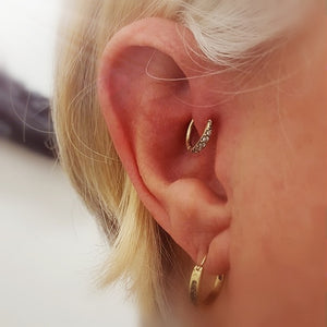 Rose gold forward helix piercing