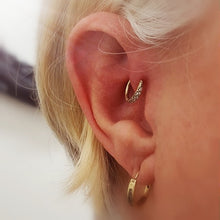 Load image into Gallery viewer, tragus piercing with a gem hoop earring