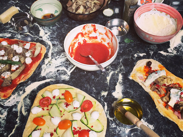 Friendship is cooking home-made pizzas together!