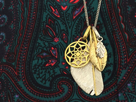 Graceful and friendship feather with the yellow gold dreamcatcher and silver oak leaf pendant