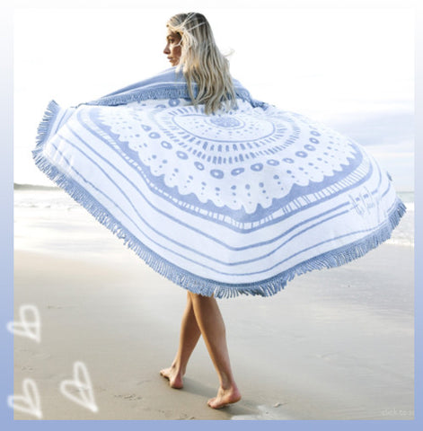 beach wardrobe edit with a Roundie Towel to shop online
