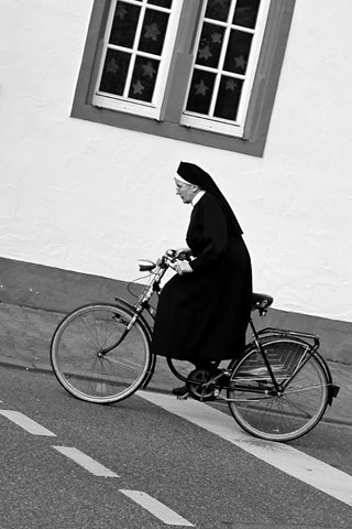 Nun on Bicycle