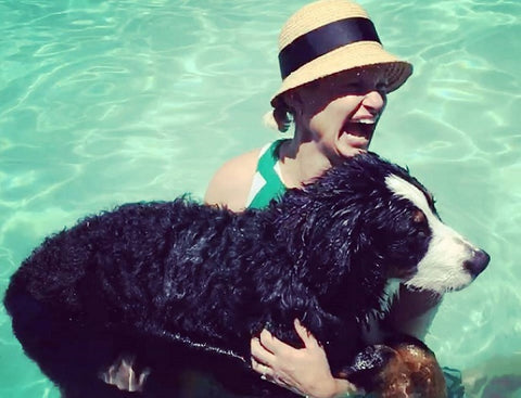 Coeur Sports Founder Kebby Holden in pool with dog