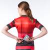 Back of women's cycling jersey with phone going in pocket.