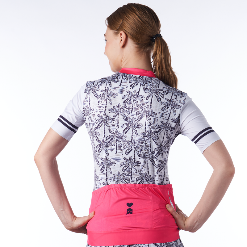 Close up back view of women's cycling jersey in palm print design