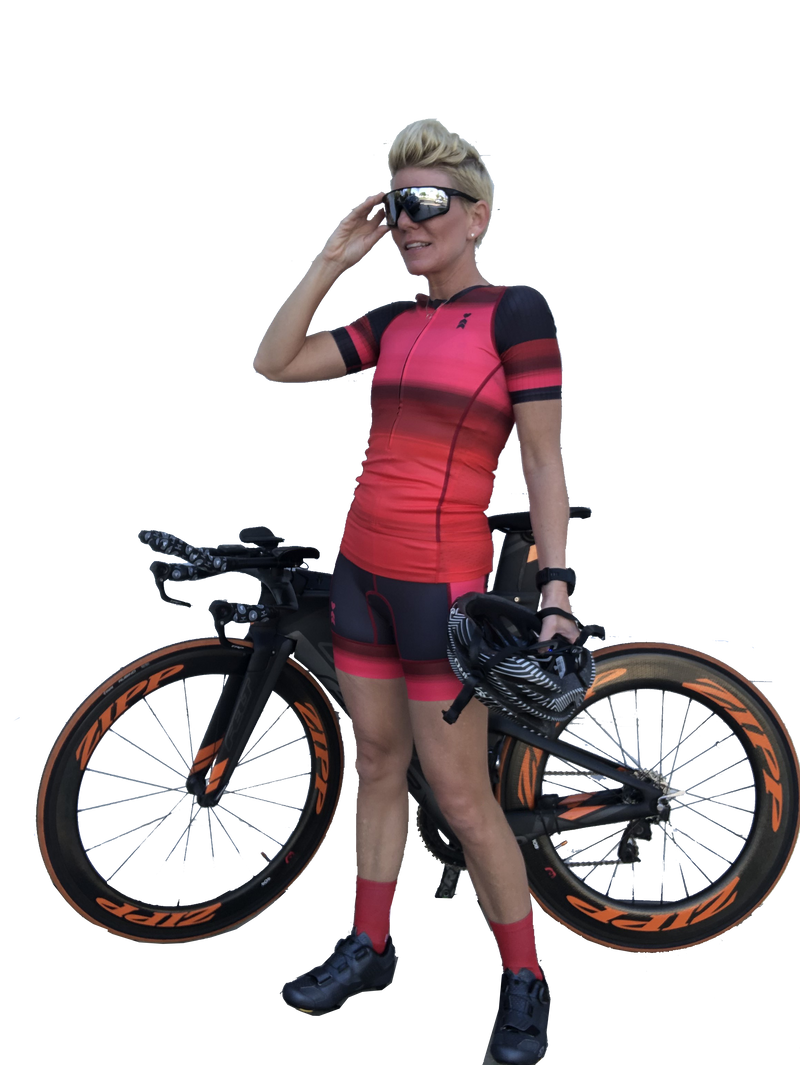 Lifestyle image of a female triathlete in a red outfit
