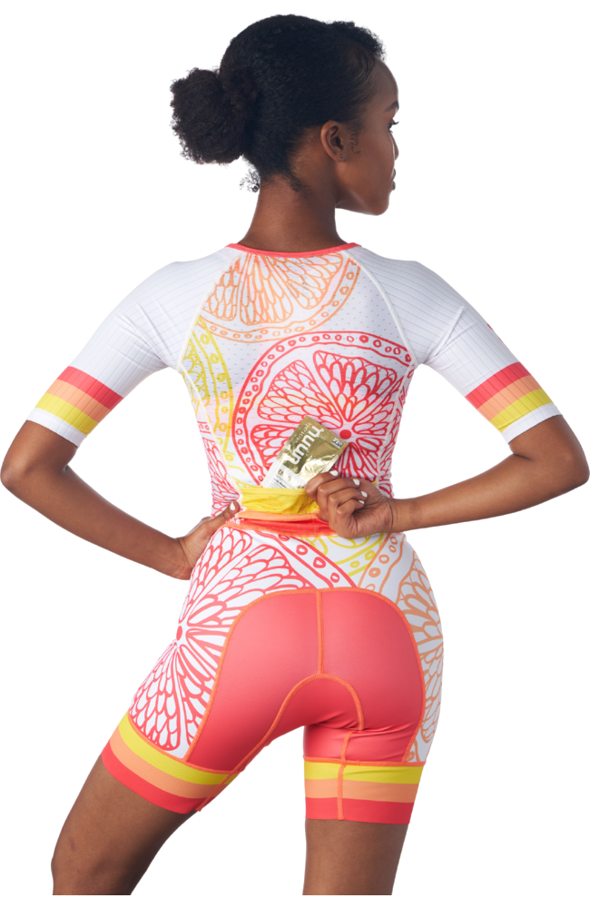 Rear view of a one piece women's triathlon race suit in a design called citrus