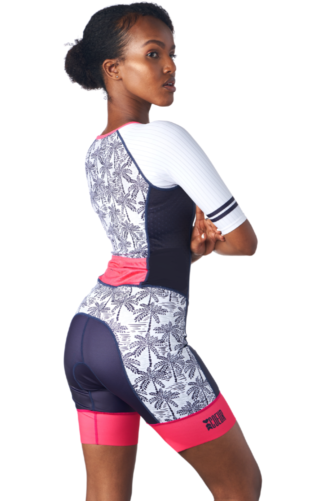 Side view of a one piece triathlon suit in a design called palm print