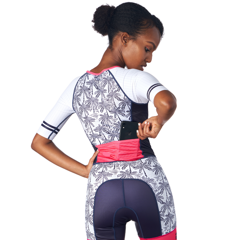 Rear view of a triathlon one piece race suit in a design called Palm Print