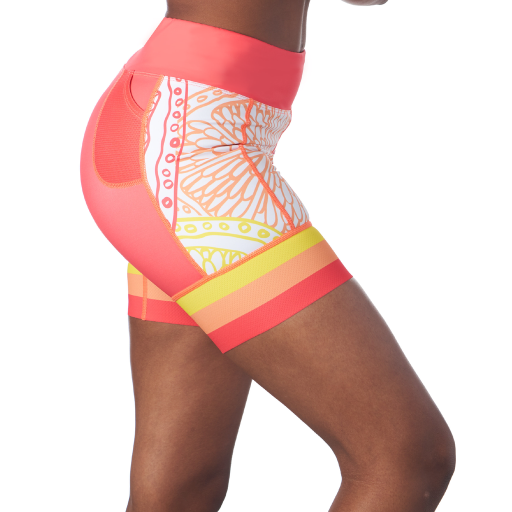 "Side view of a triathlon shorts for women with 5"" inseam in a design called citrus"