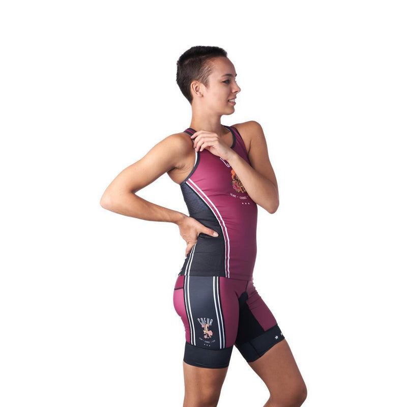 Woman in burgundy and black triathlon shorts and jersey