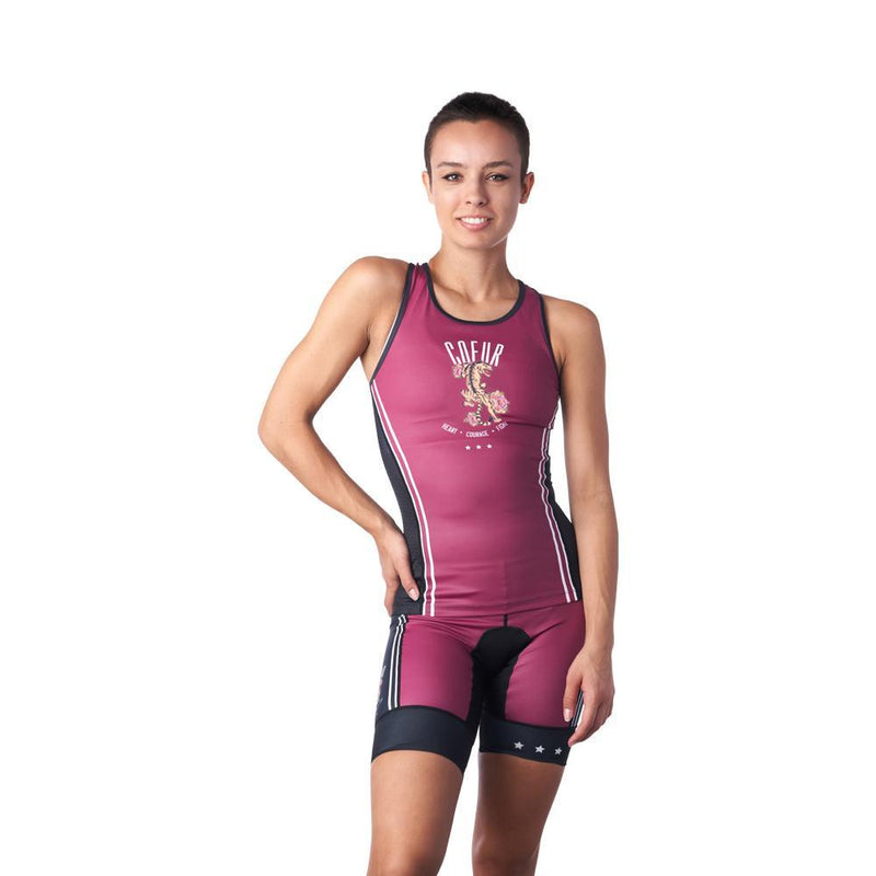 Woman in triathlon tank top and shorts that are burgundy and black
