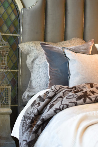 Linen jacquards, velvet and cashmere in a melodious melange resting on and ivory woven cashmere bedcover from Biella Italy.