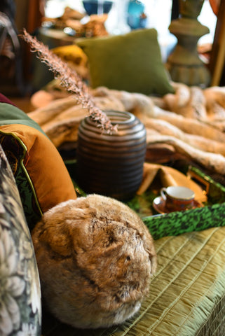 Faux furs make the most splendid layer in cozy throws and fun rounds balls