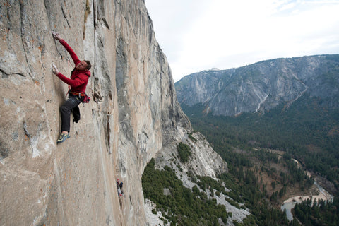 Tommy Caldwell hangs above Yosemite Valley on The Dawn Wall