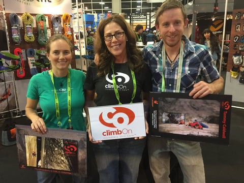 Beth Rodden, climbOn Bar creator Polly Glasse, and Tommy Caldwell at The Outdoor Retailer Show in 2015 in Salt Lake City, Utah