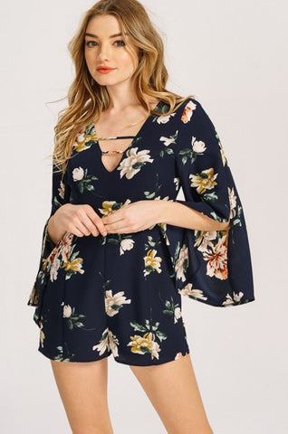 spring romper outfit with floral pattern