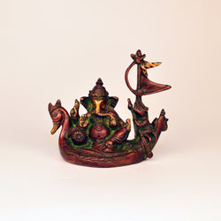 Multicolored Brass Ganesh Idol in Boat - FOLKBRIDGE.COM | Buy Gifts. Indian Handicrafts. Home Decorations.